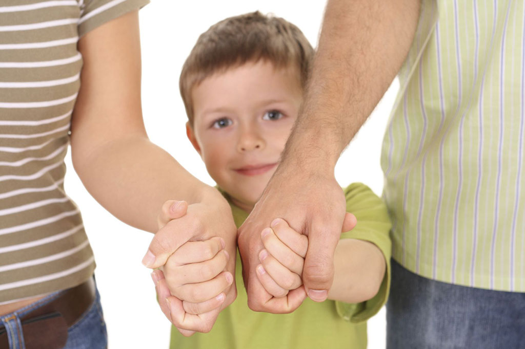 Child holding adult hands